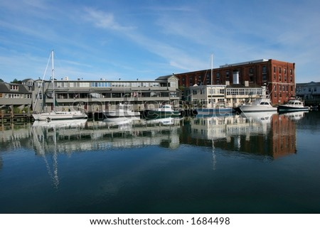 buildings and boats along river in Mystic, Connecticut - stock photo