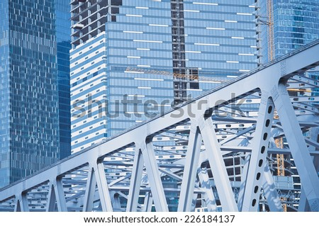 buildings and bridge under construction in the modern city. - stock photo