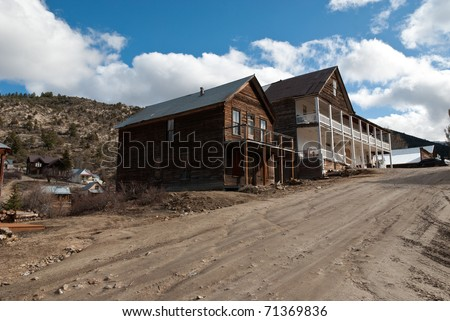 Buildings in an old mining ghost town - stock photo