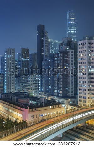 Buildings in Hong Kong at night - stock photo