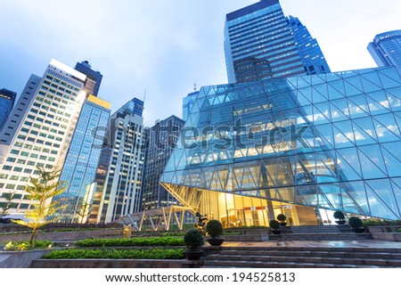 buildings in modern city at night - stock photo