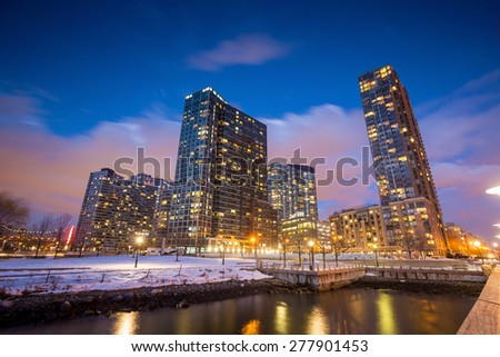 Buildings of long island in front of east river at twilight - stock photo