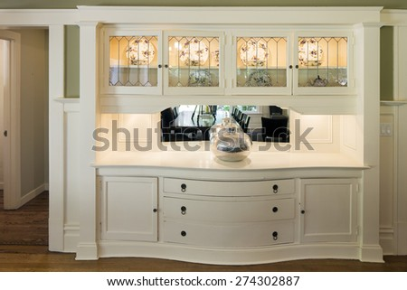 Built In curved Dining Room Cabinet in white.  - stock photo