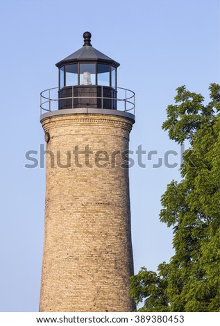 Built in 1866, The Old Lighthouse, formerly the Southport Light, in Kenosha, Wisconsin stands against a clear blue morning sky. - stock photo