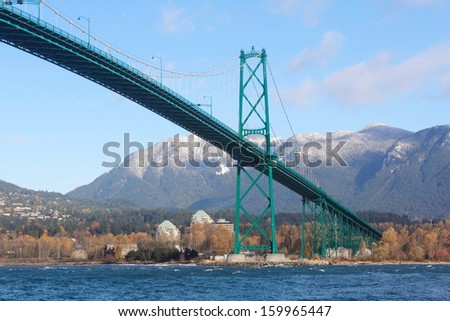 Built in the 1930s, Vancouver's Lions Gate Bridge spans across Burrard Inlet to the Northshore/Vancouver's Lions Gate Bridge/Lions Gate Bridge and Vancouver's Northshore. - stock photo