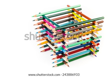 Built square construction of various colored crayons - stock photo