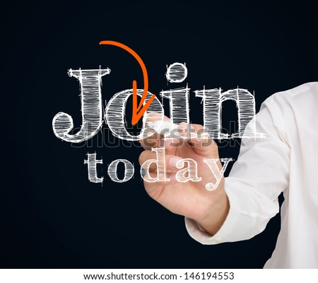 Buisnessman drawing join today message on black background with orange arrow - stock photo