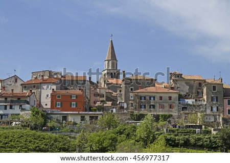 Buje - idyllic small town on a hill high above the Mirna Valley - stock photo