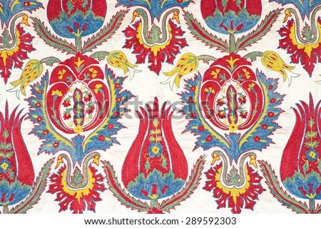 Bukhara suzani uzbekistan earty 20th century silk satin base tulip handcraft peruvian style rug surface close up detail pattern arabic fashionable textile. - stock photo