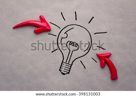bulb hand drawing with arrow business idea concept - stock photo