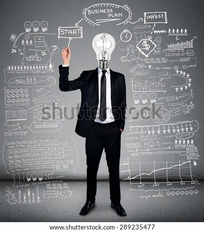 Bulb head man writing business plan - stock photo