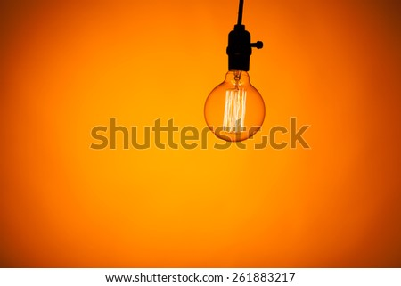 bulb lamp with warm light background - stock photo