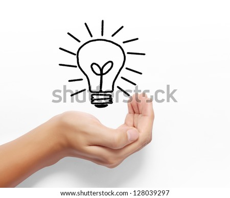 Bulb light on hand on white background - stock photo