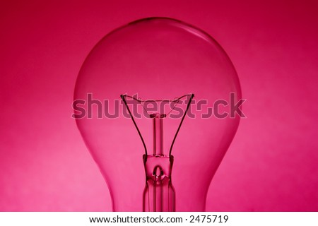 Bulb over a pink background - stock photo