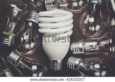 bulb uniqueness concept on the brown wooden table - stock photo