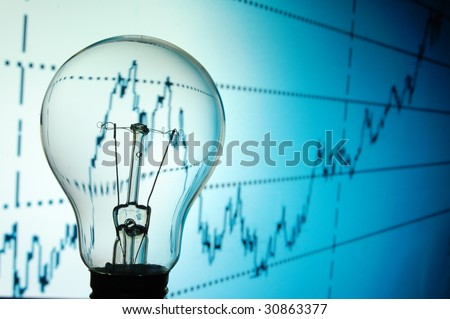 bulb with business background showing concept of success an idea - stock photo