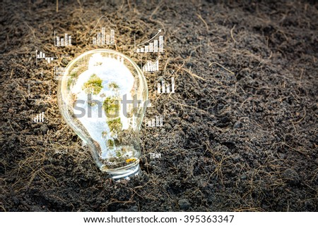 Bulb with business graph - stock photo