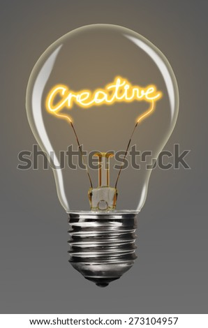 bulb with glowing creative word inside of it, creativity concept - stock photo
