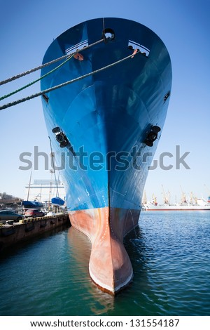 bulbous bow ship moored towering - stock photo