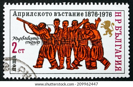 BULGARIA - CIRCA 1976: a stamp printed in the Bulgaria shows Peasants with Rifle and Proclamation, Centenary of Uprising Against Turkey, circa 1976 - stock photo