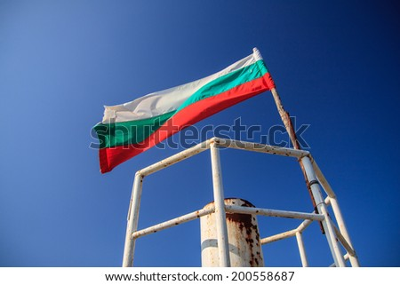 Bulgaria flag in blue sky - stock photo