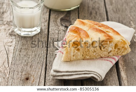Bulgarian cheese pastry with cup of milk - stock photo