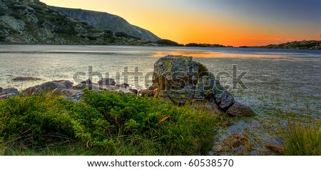 bulgarian mountain lake in dusk time - stock photo