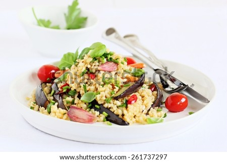 Bulgur salad with vegetables and herbs on a white background.Selective focus. - stock photo