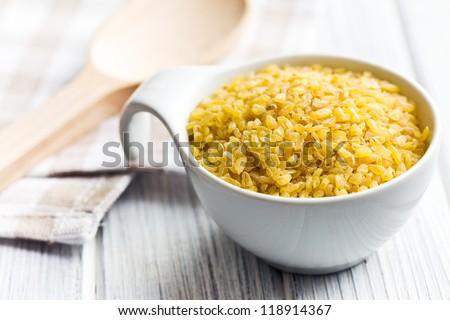 bulgur wheat in ceramic bowl - stock photo