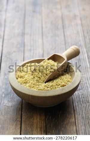 bulgur wheat, Turkish food isolated on wooden background - stock photo