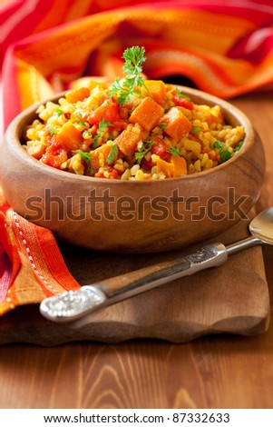 Bulgur  with tomatoes and  butternut squash - stock photo