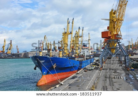 Bulk cargo ship under port crane bridge, Odessa, Ukraine - stock photo