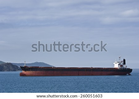 Bulk carrier Ricstar moves into port. Nakhodka Bay. East (Japan) Sea. 17.05.2014  - stock photo