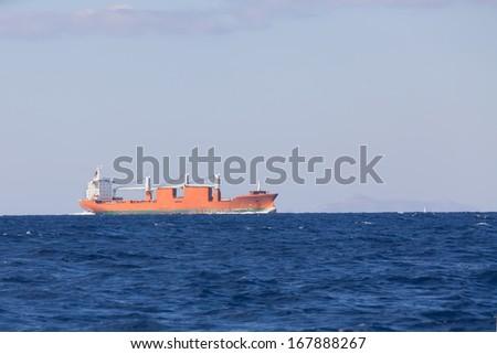 Bulk-carrier ship sailing in the sea  - stock photo