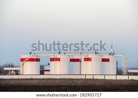 bulk oil storage tanks or gasoline reservoirs - stock photo