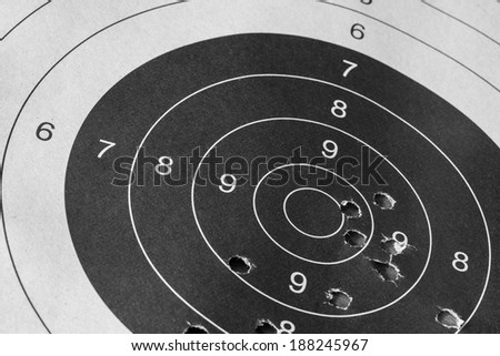 Bull eye target with bullet hole - stock photo