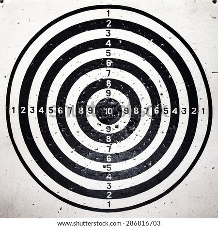 Bull eye target with bullets holes - stock photo