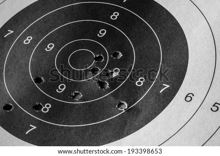 Bull eyetarget with bullet hole - stock photo