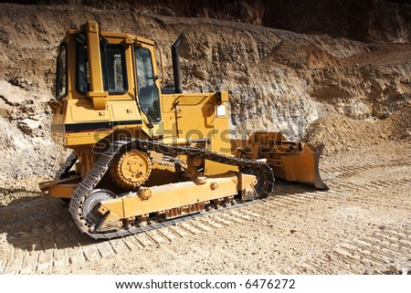 Bulldozer at construction yard - stock photo