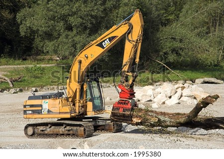 Bulldozer at the beach - stock photo