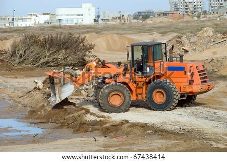 Bulldozer in the city building site - stock photo