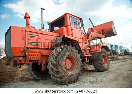 Bulldozer on sand. heavy construction loader bulldozer at construction area - stock photo