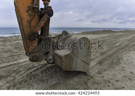 Bulldozer on the beach. - stock photo