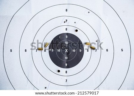 Bullet casings lay on the target - stock photo