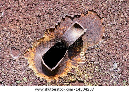 Bullet hole in a old steel panel - stock photo