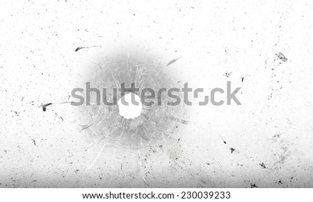 Bullet hole in glass on dirty grungy white background - stock photo