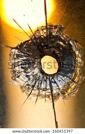 Bullet hole in the  window - stock photo
