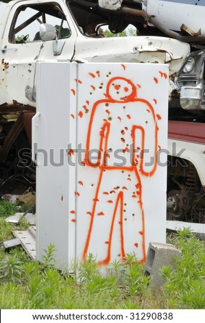 Bullet-riddled Refrigerator - stock photo