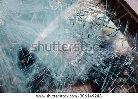 bulletproof glass car after the shooting with traces of bullets - stock photo