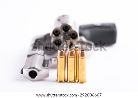 bullets and revolver on white background - stock photo